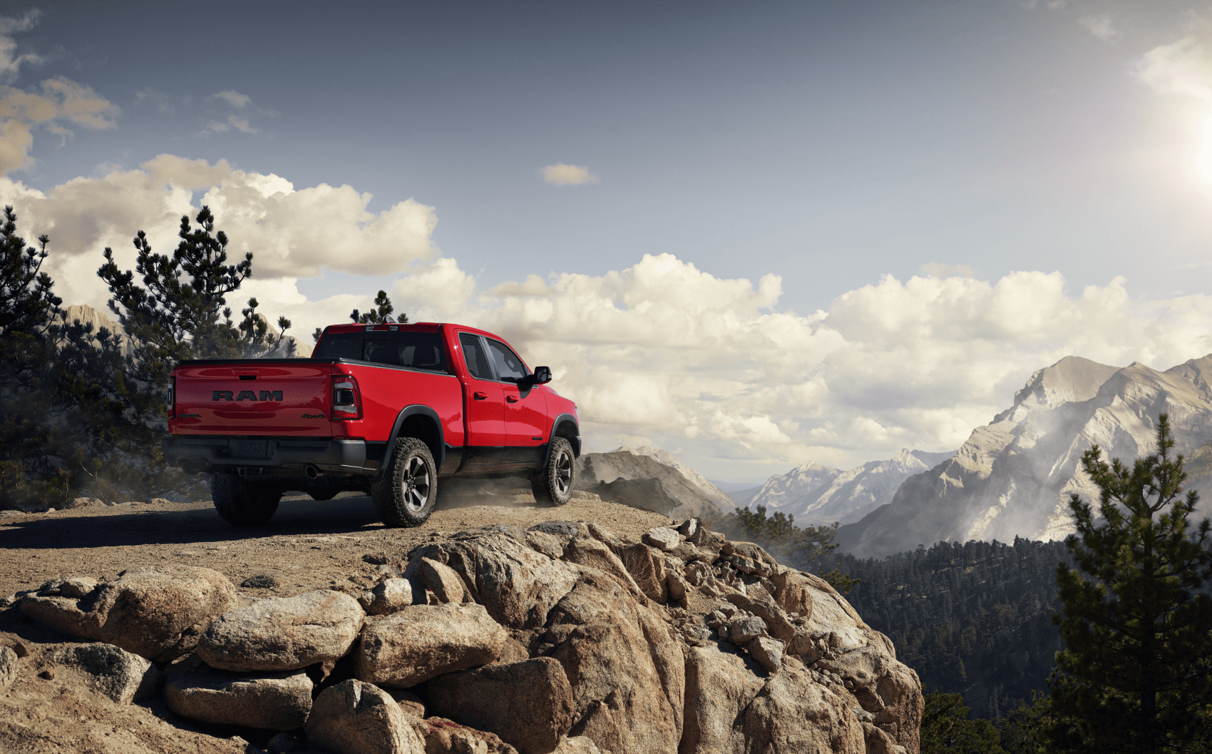 2021 Ram 1500 Rebel Flame Red Distant Mountain C. Harper CDJR
