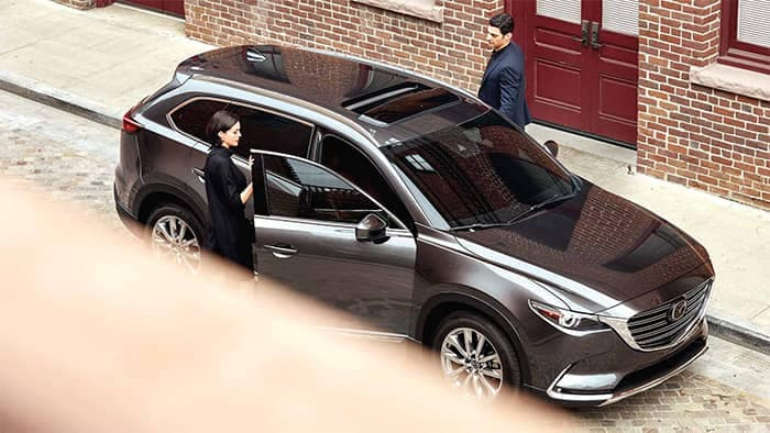 Couple getting into 2019 Mazda CX-9