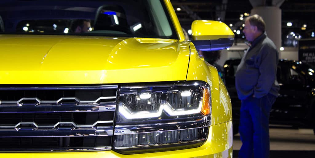 Headlights of the All-New Volkswagen Atlas in Kurkuma Yellow Metallic is on display at the 2017 Vancouver International Auto Show