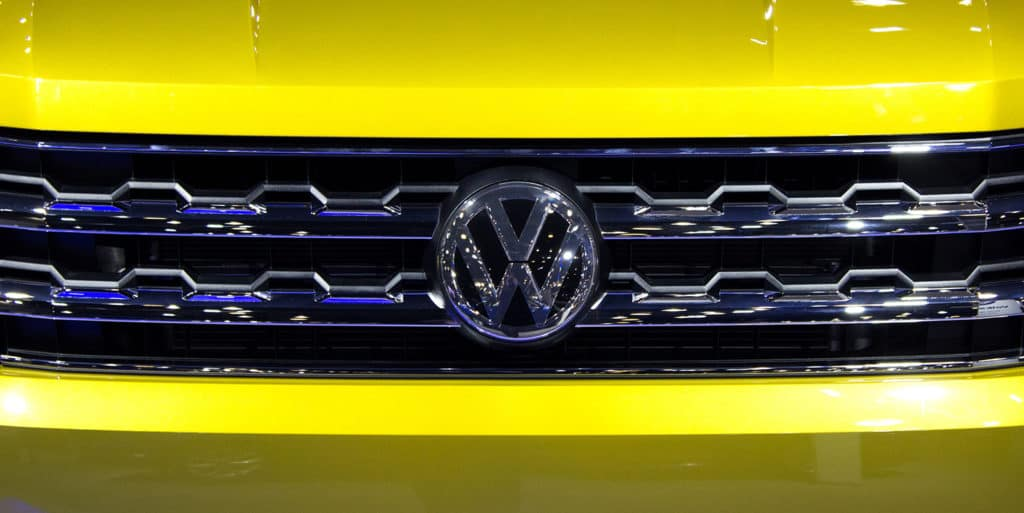 Front Grill of the All-New Volkswagen Atlas in Kurkuma Yellow Metallic is on display at the 2017 Vancouver International Auto Show