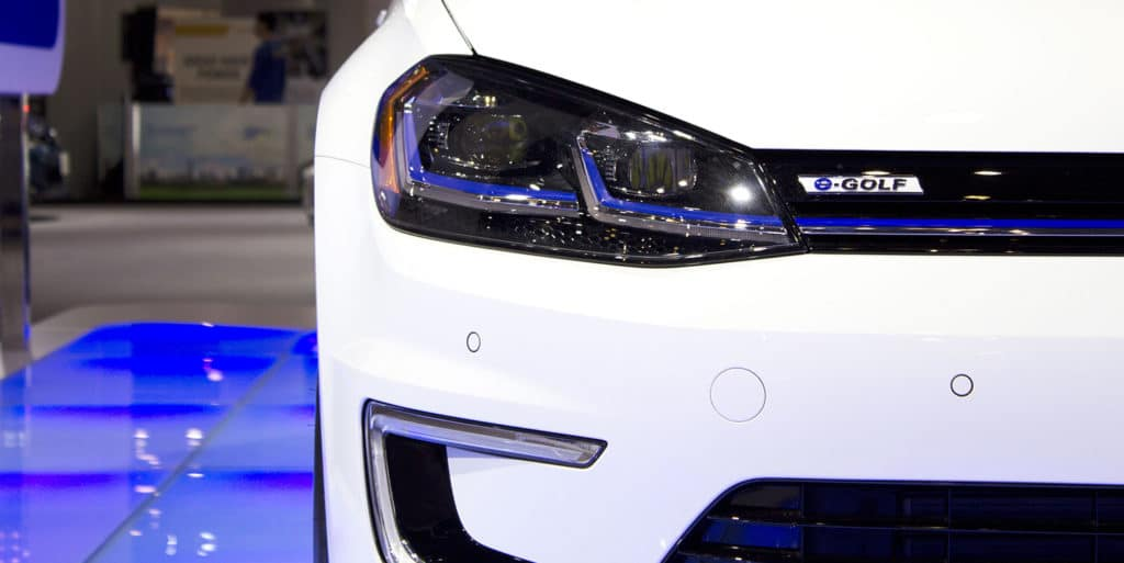 Headlights ofVolkswagen e-Golf, VW's first EV (electric vehicle) is on display at the 2017 Vancouver International Auto Show