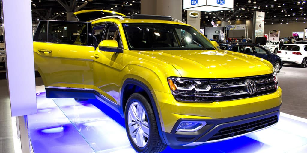 The All-New Volkswagen Atlas in Kurkuma Yellow Metallic is on display at the 2017 Vancouver International Auto Show