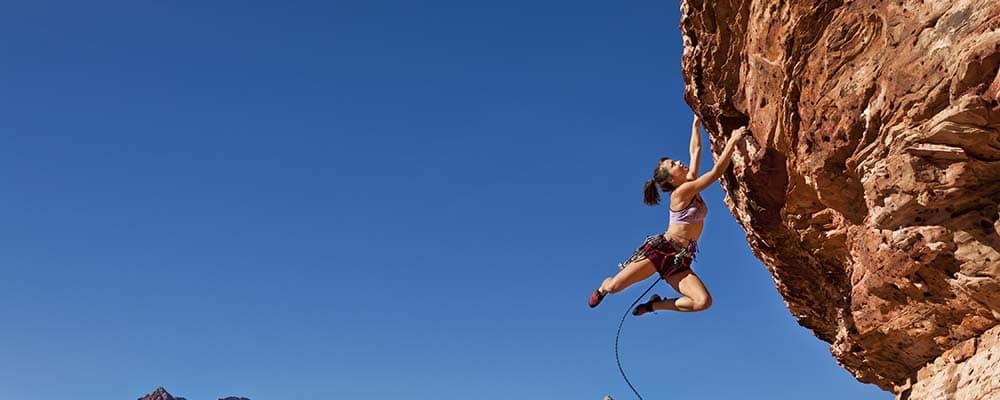 woman rock climbing