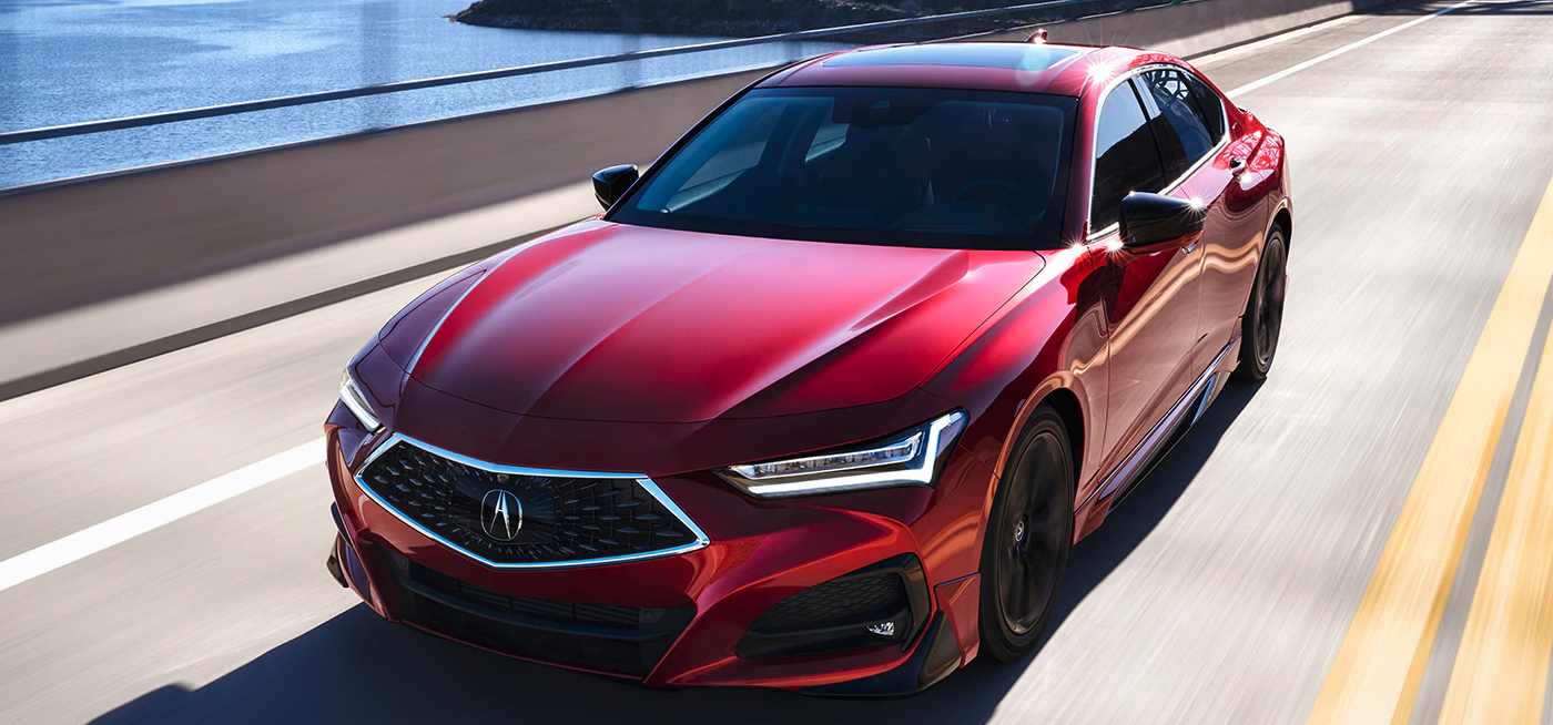 2021 Acura TLX driving down road