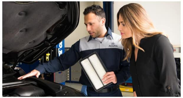Acura service tech with customer and engine air filter
