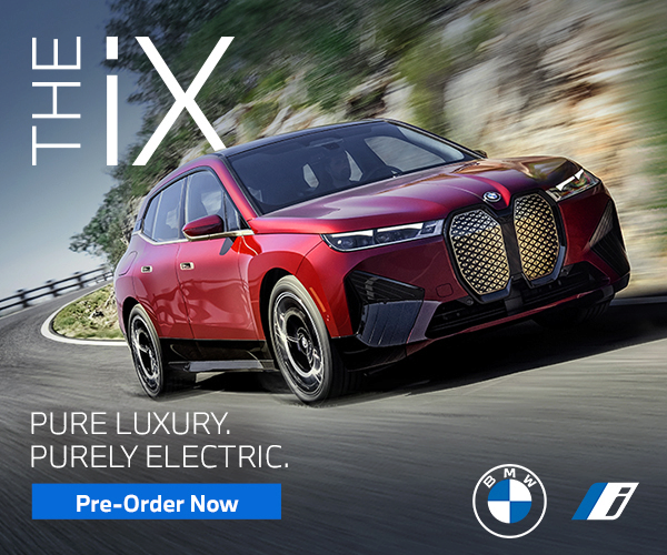 Image of red iX vehicle. Click to preorder the iX.