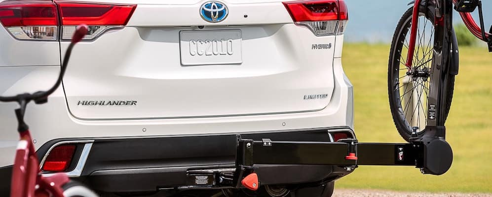 White 2019 Toyota Highlander with Bike Rack Accessory on Hitch