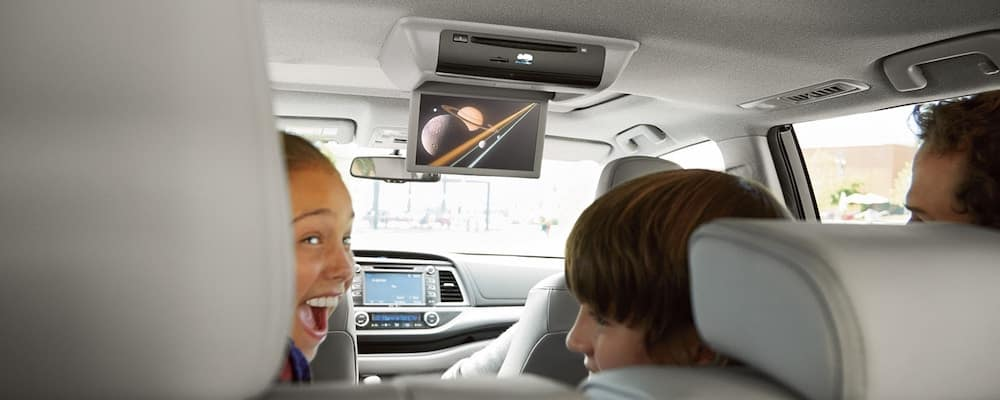 Kids watching Blu Ray of planets inside 2019 Toyota Highlander interior