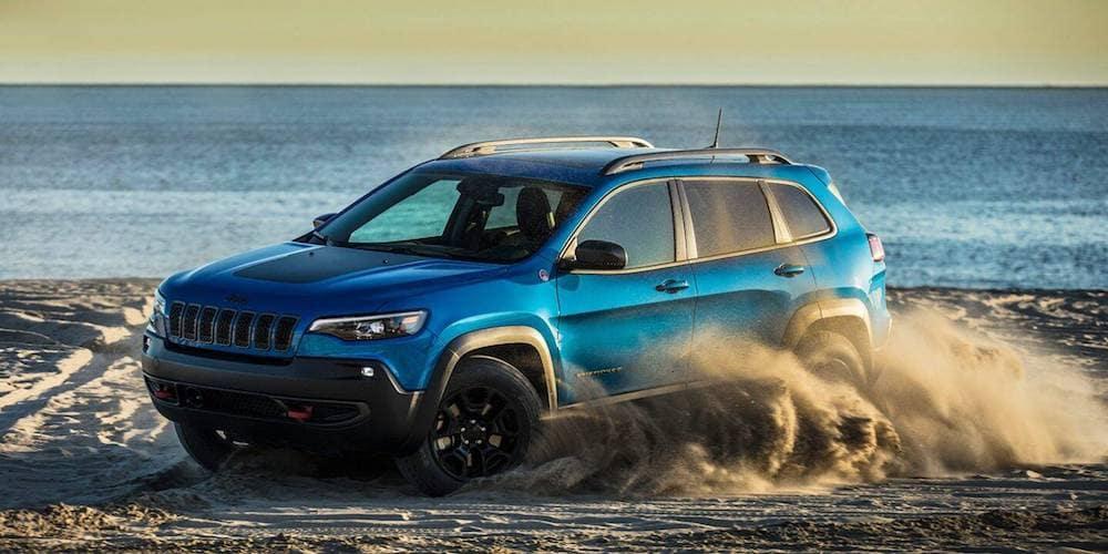 Blue 2020 Jeep Cherokee Trailhawk on Beach