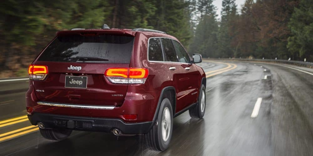 Red 2020 Jeep Grand Cherokee on Highway