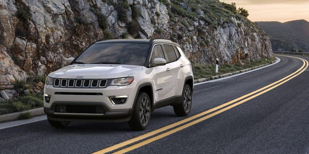 2020 White Jeep Compass on Highway