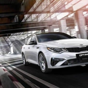 2019-Kia-Optima-driving-white