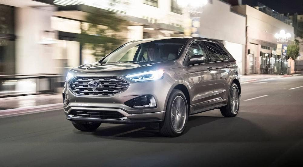 A Silver  Ford Edge Travels A City City Street In Ohio At Night