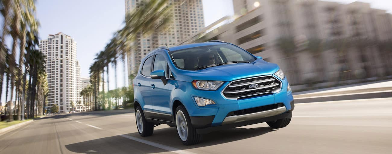 A light blue 2019 Ford EcoSport cruises down a city street