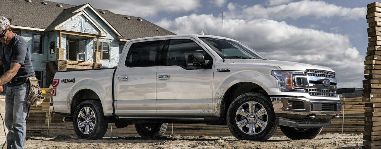 White 2019 Ford F150 at construction site