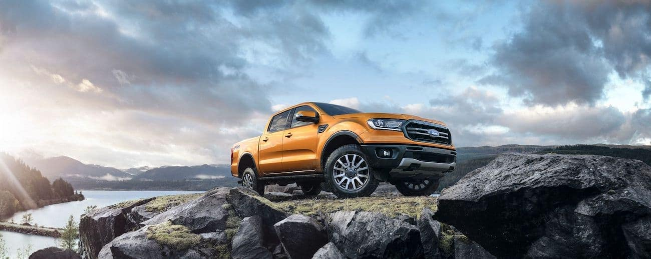 A bright copper colored 2019 Ford Ranger on a pile of large rocks