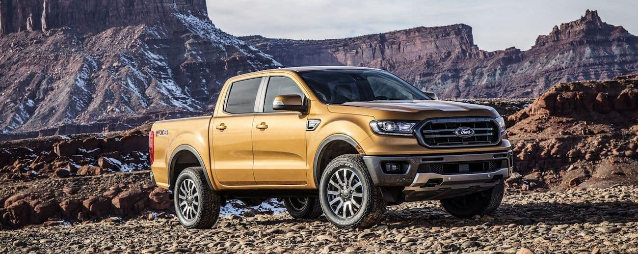 A bright copper colored 2019 Ford Ranger off roading on a rocky path