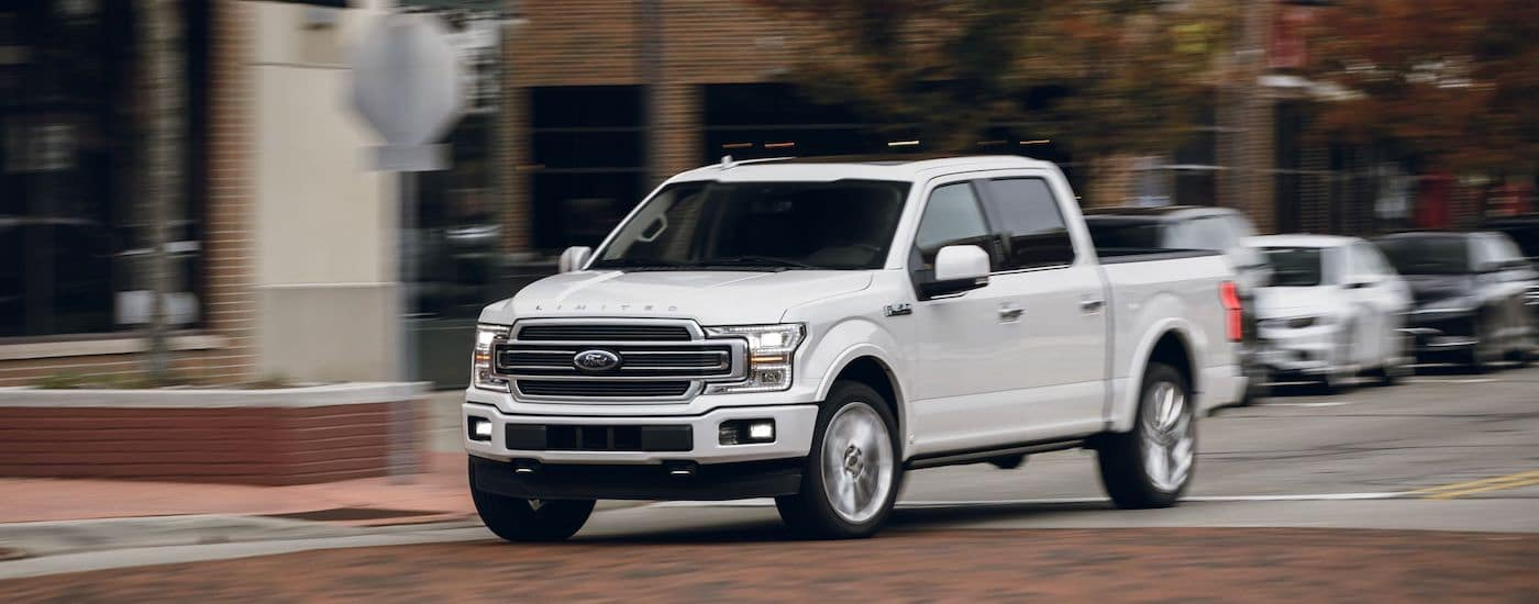 A white 2019 Ford F-150 Limited on a test drive from a Ford Dealer in Ohio
