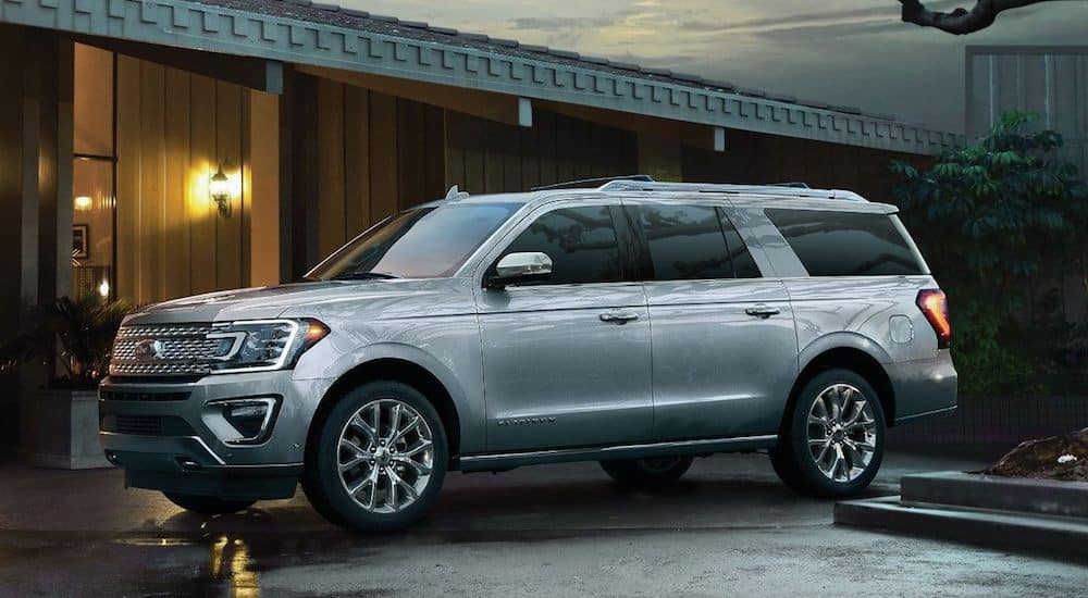 A silver 2019 Ford Expedition parked outside an upscale Cincinnati home