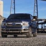 A blue 2019 Ford F-150 drives through a Ohio factory