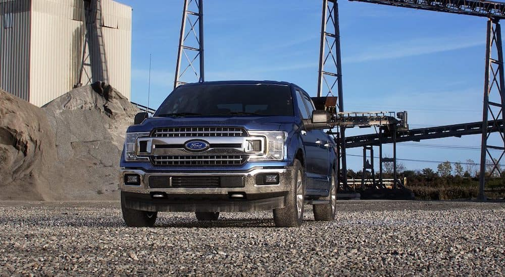 A blue 2019 Ford F-150 from the front drives through an Ohio gravel pit