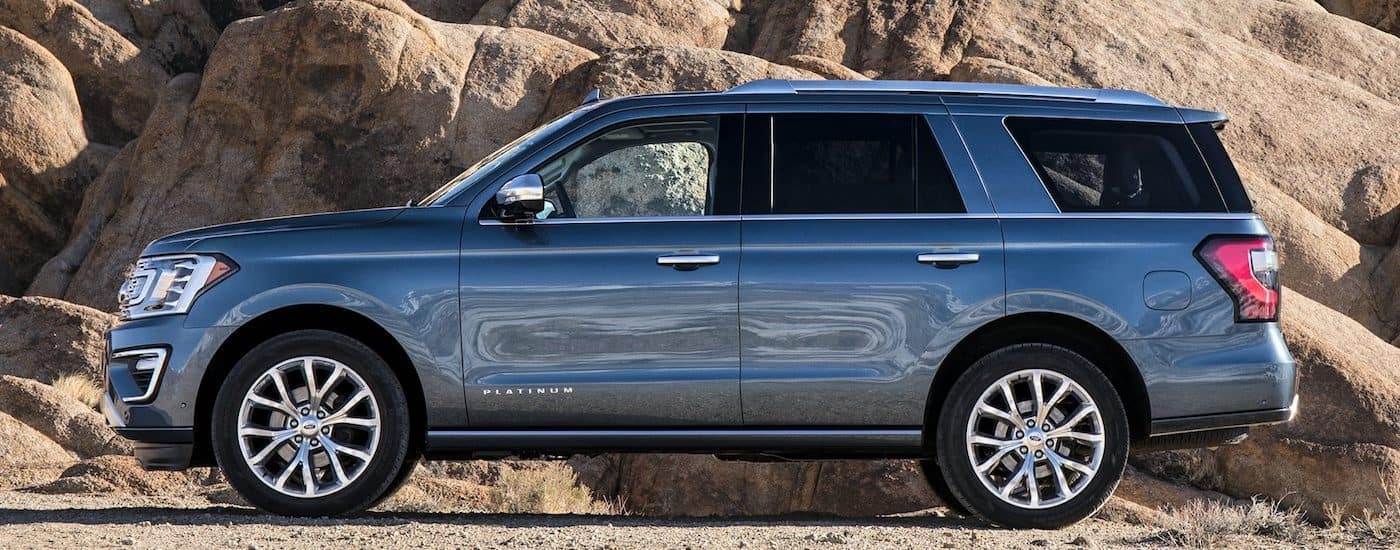 Blue 2019 Ford Expedition Platinum parked against cliff