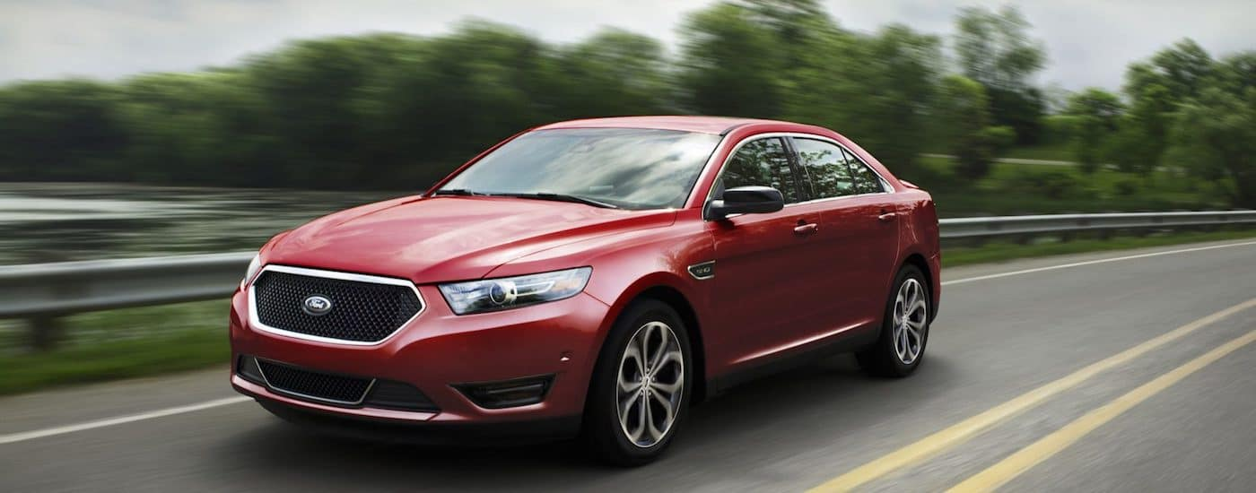 Red 2019 Ford Taurus driving
