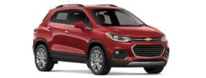 A red 2019 Chevy Trax facing right on white