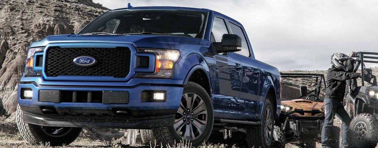 In the battle of 2019 Ford F-150 vs 2019 Nissan Titan a blue 2019 Ford F-150 off-roads in victory