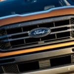 A closeup of the grille on a new orange 2019 Ford Ranger