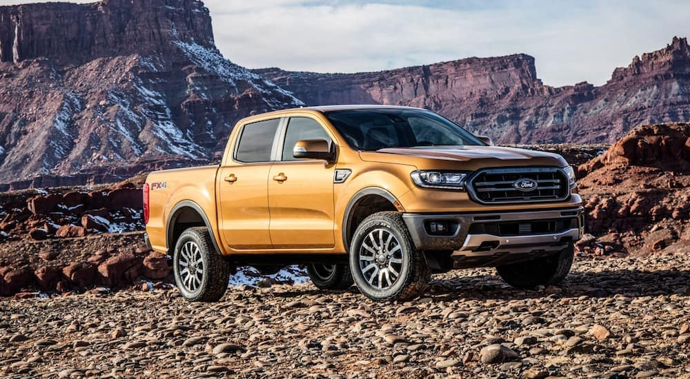 An orange 2019 Ford Ranger with mountains in the back