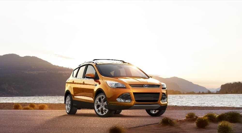 A 2016 Used Ford Escape at a lack at sunset