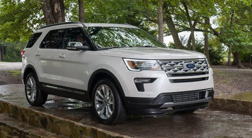 A white 2019 Ford Explorer XLT parked in front of trees