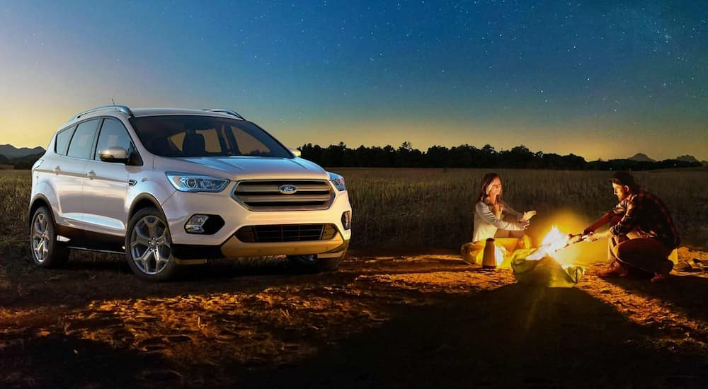 A white 2019 Ford Escape at a campfire