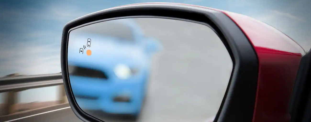 The Cross Traffic Alert feature is shown in the 2019 Ford Escape's mirror.