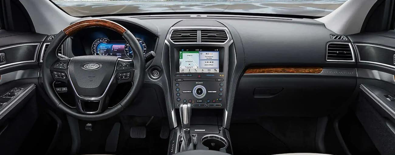 The black interior of a 2019 Ford Explorer is shown. Check out entertainment when comparing the 2019 Ford Explorer vs 2019 Honda Pilot in Cincinnati, OH.