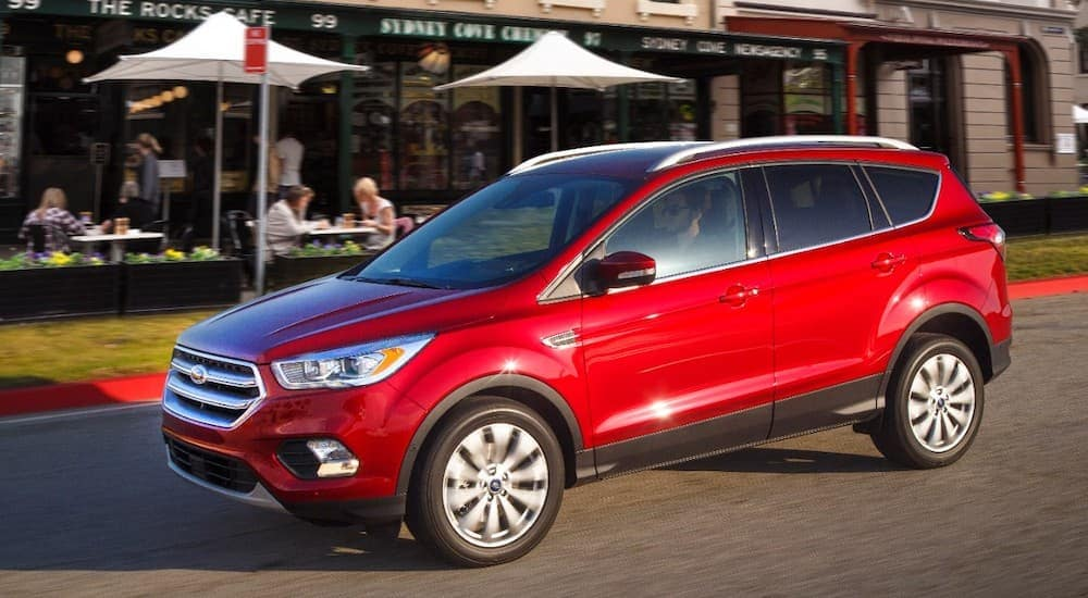 A red, Ford Certified Pre Owned, 2017 Escape is in front of a cafe in Cincinnati, OH.