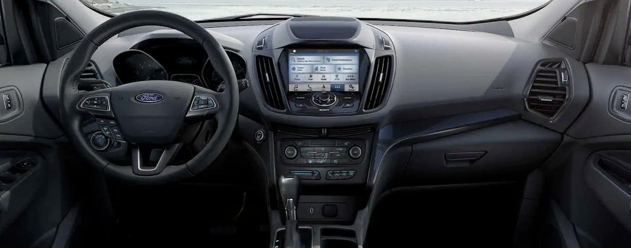 The black interior of a 2019 Ford Escape is shown.