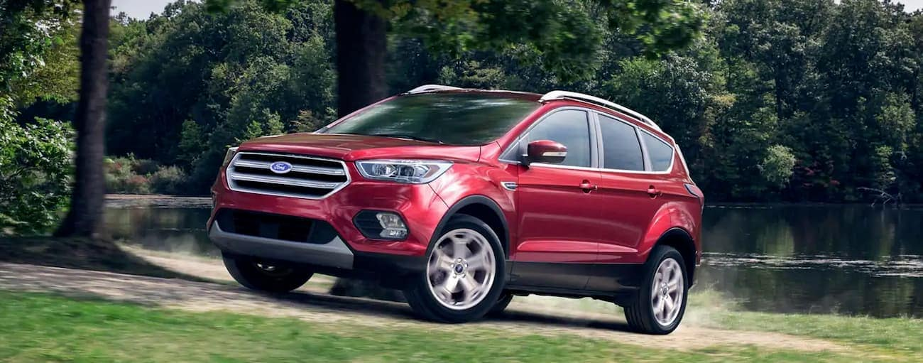 A red 2019 Ford Escape is pulling away from a pond near Cincinnati, OH.