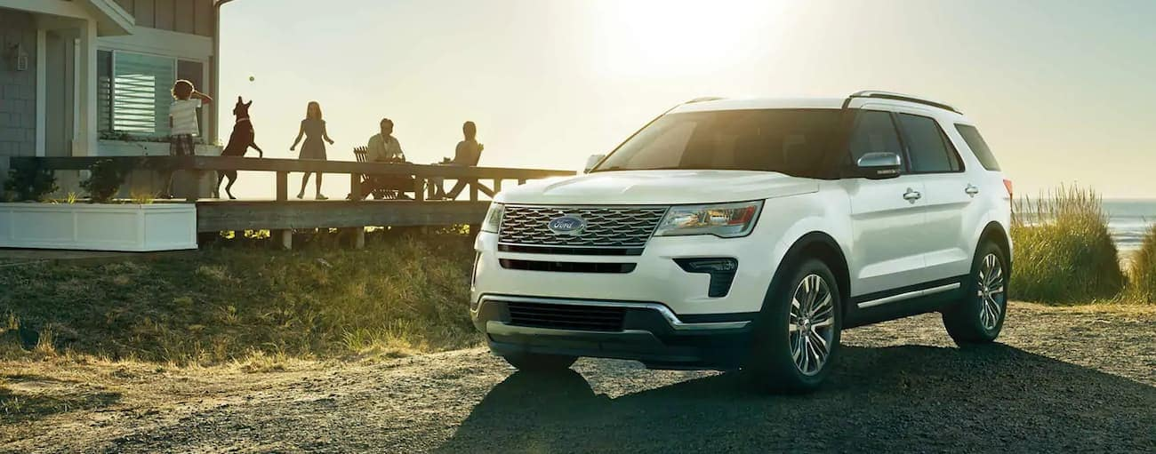 A white 2019 Ford Explorer is parked at a beach house. Check out safety when comparing the 2019 Ford Explorer vs 2019 Chevy Traverse in Cincinnati, OH.