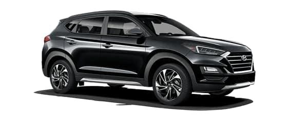 A black 2019 Hyundai Tucson is facing right.