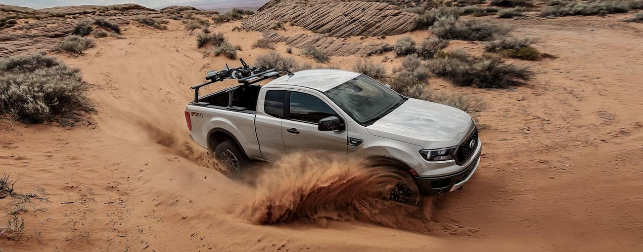 A tan 2019 Ford Ranger is cornering on a trail in the desert.