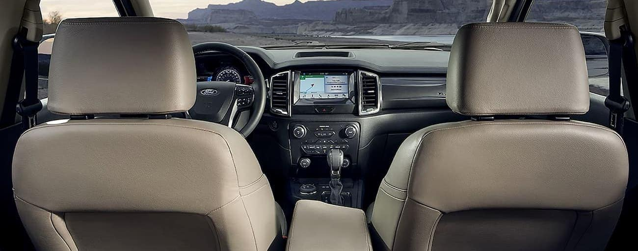 The black and white interior of the 2019 Ford Ranger, which wins when comparing the 2019 Ford Ranger vs 2019 Chevy Colorado in Cincinnati, OH, is shown.