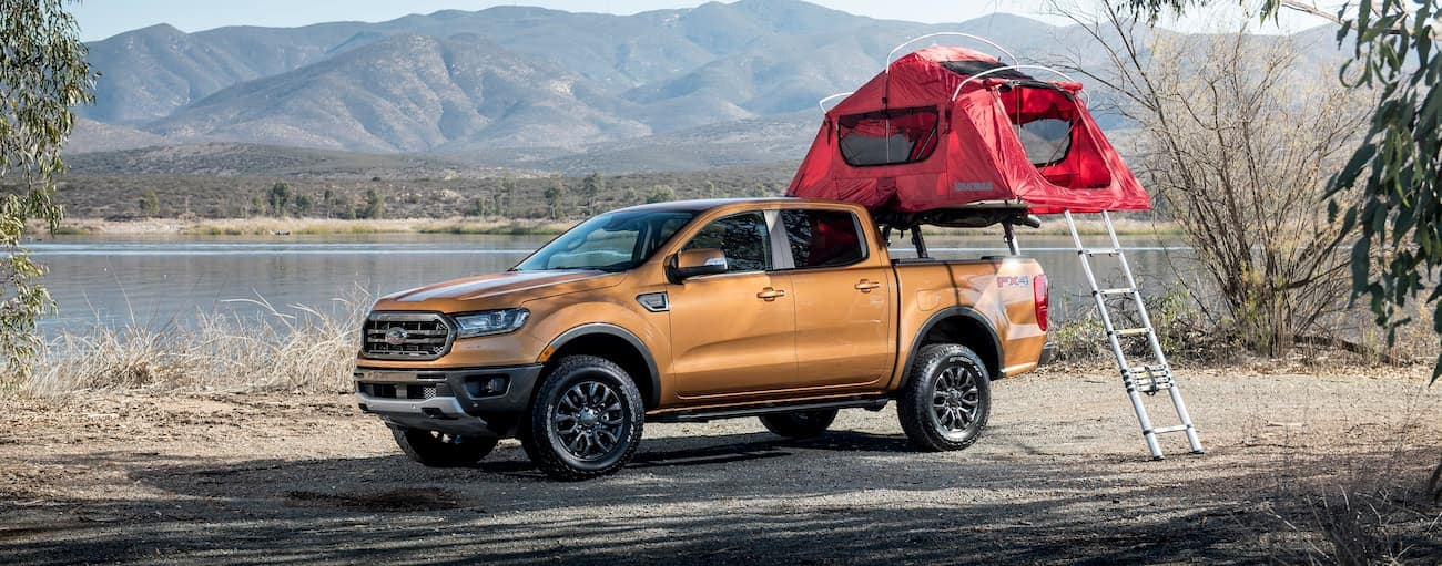 A gold 2019 Ford Ranger has a truck bed tent set up while on vacation far from Cincinnati, OH.