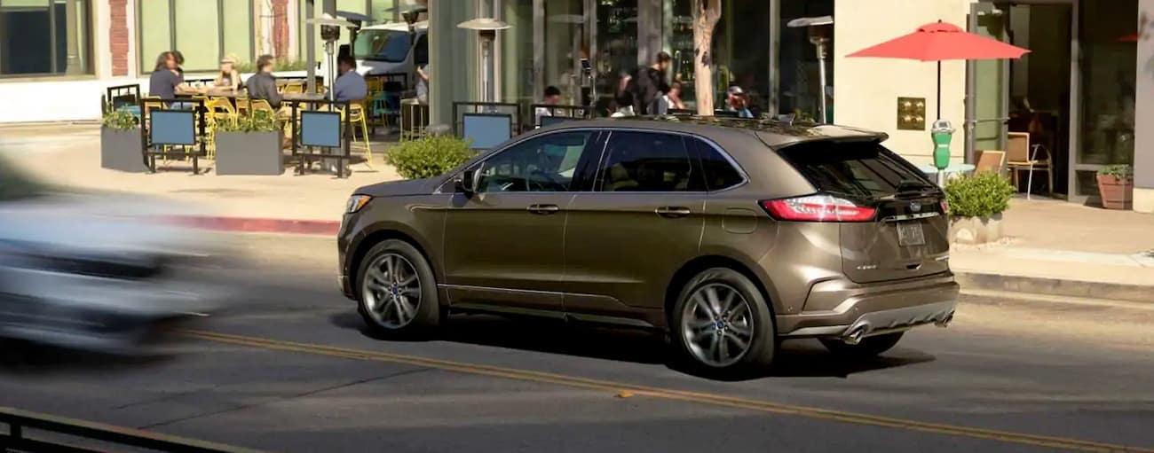 A tan 2019 Ford Edge is on a busy street in Cincinnati, OH.