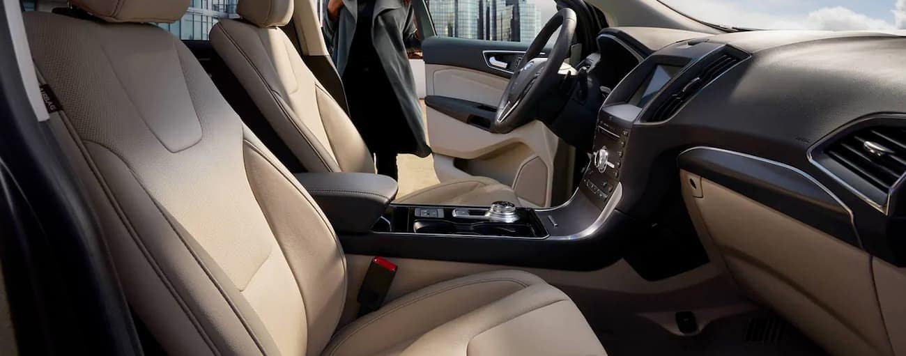 The tan interior of a 2019 Ford Edge, which wins when comparing the 2019 Ford Edge vs. 2019 Hyundai Santa Fe, is shown.
