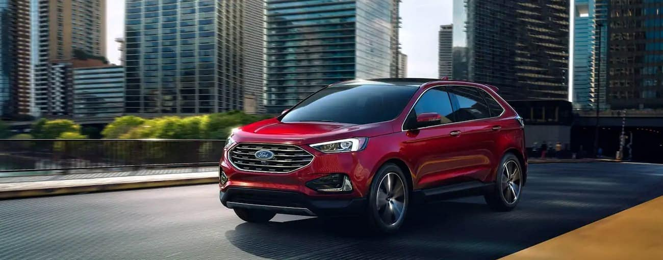 A red 2019 Ford Edge is driving out of Cincinnati, OH.