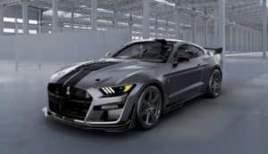 A grey Venom edition 2020 Shelby GT500 is in a warehouse.
