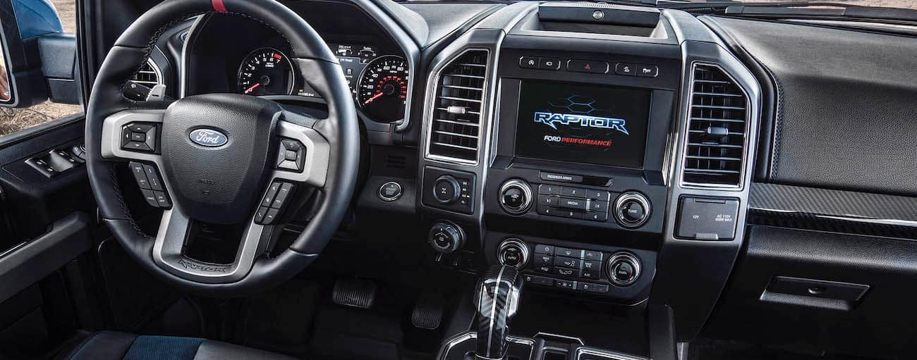 The black interior of a 2019 Ford Raptor is shown in Cincinnati, OH.