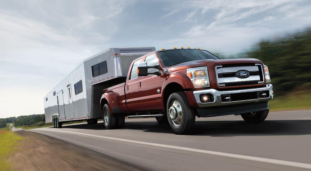 A red 2017 Ford Super Duty is towing a trailer on a highway outside Cincinnati, OH.